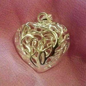 Silver Plated Filigree Hollow Puffy Heart Pendant
